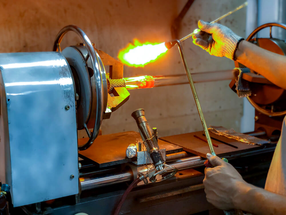 Worker using a torch for glasswork