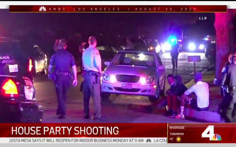 News footage of police officers and cars in an Arcadia neighborhood at night.